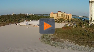 Hotel resort on beach with outdoor tent on the sand visible